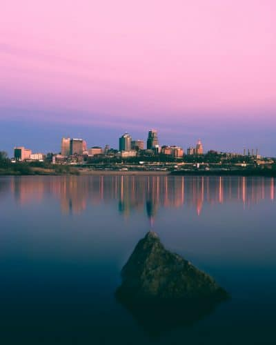 high-rise buildings against pink sky